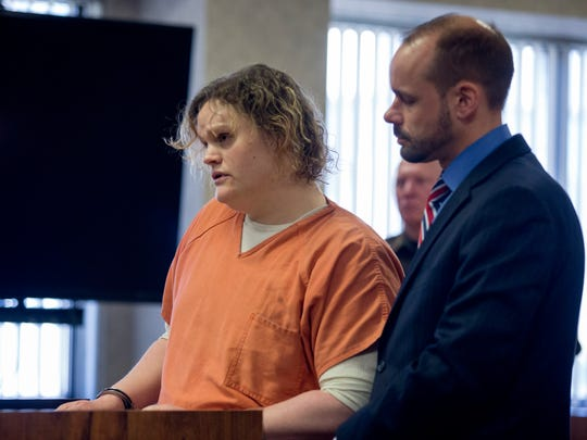 Elizabeth Long reads a letter to Judge Michael West while standing next to her lawyer, James Fifelski, during sentencing Thursday, April 14, 2016 at the St. Clair County Courthouse in Port Huron. Elizabeth Long was sentenced to 22 to 50 years in prison for second-degree murder and second-degree child abuse in the death of her 16-month-old son, Lukas.