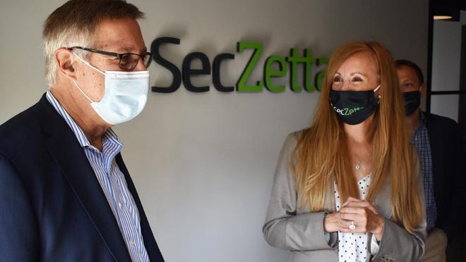 Massachusetts State Sen. Michael Rodrigues and Nicole Rowe, VP of Marketing for SecZetta, tour the new Fall River facility.
