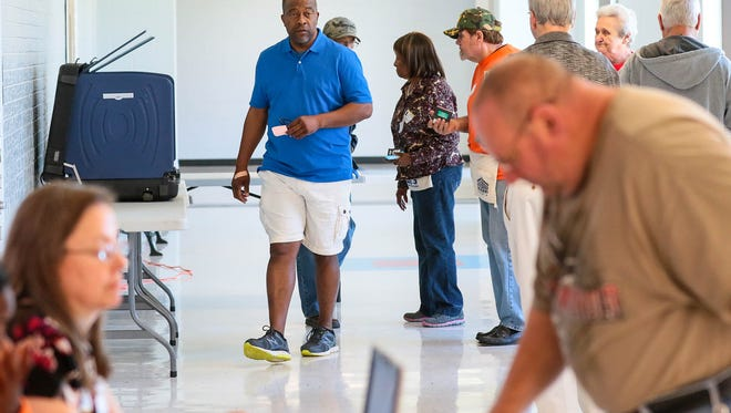 Gary Burgess of Pendleton finishes voting at Pendleton Elementary School during the referendum on Anderson School District 4's $79 million bond issue.