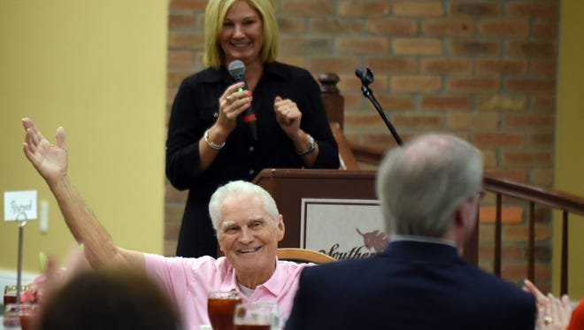 In this 2016 file photo, Paul Ott Carruth raises his hand as his daughter Carla Carruth Tigner recognizes them as both breast cancer survivors during Forrest General's Spirit of Women Girls' Day Out event.