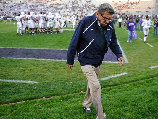 Penn State coach Joe Paterno walks off the field after warmups before an October football game against Northwestern in Evanston, Ill. NCAA president Mark Emmert says he isn't ruling out the possibility of shutting down the Penn State football program in the wake of the Jerry Sandusky child sex abuse scandal.