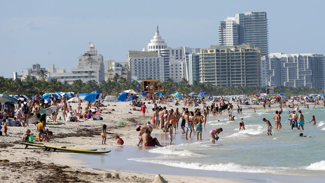 Beachgoers enjoy a day on Miami Beach, Florida's famed South Beach.