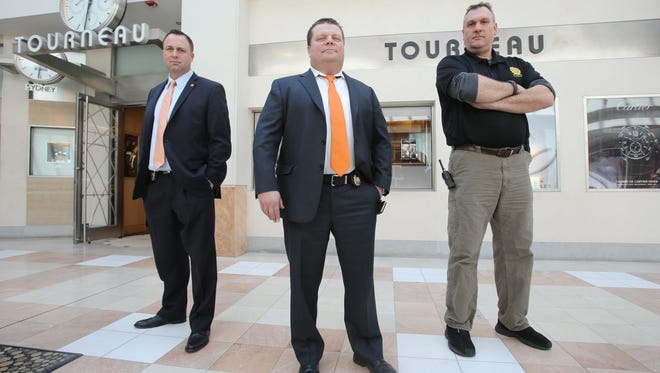From left, White Plains Detectives Peter Vallely, Lt. Eric Fischer and Jamie Douglass, who cracked the smash-and-grab robbery of Rolex watches from the Tourneau store at The Westchester mall last year.
