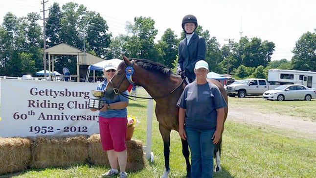 The Adams County Pleasure horse for 2016 trophy was presented to Kristina Fowler, riding Beau N Eros, by Wendy Dutterer, right, of Saw Horse Farm in Hunterstown and Carol Kessel, left, president of the Gettysburg Riding Club.