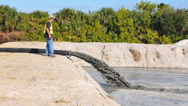 A pipe brings sludge from a dredge to the holding area where the solids settle and the water is filtered before returning to the Indian River Lagoon. The first phase of dredging began in early 2016 in north Cocoa Beach in the canal between Jack Drive and Kent Drive.