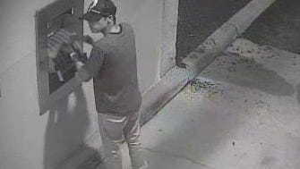 Law enforcement is looking for this man, caught on camera trying to break into a bank night deposit box.