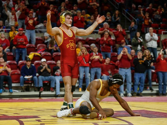 Iowa State sophomore Chase Straw reacts after beating Wyoming's Archie Colgan in their match at 157 pounds at Hilton Coliseum in Ames on Saturday, Dec. 9, 2017.