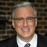 """In this Oct. 24, 2011, file photo, Keith Olbermann leaves a taping of """"Late Show with David Letterman"""" in New York."""