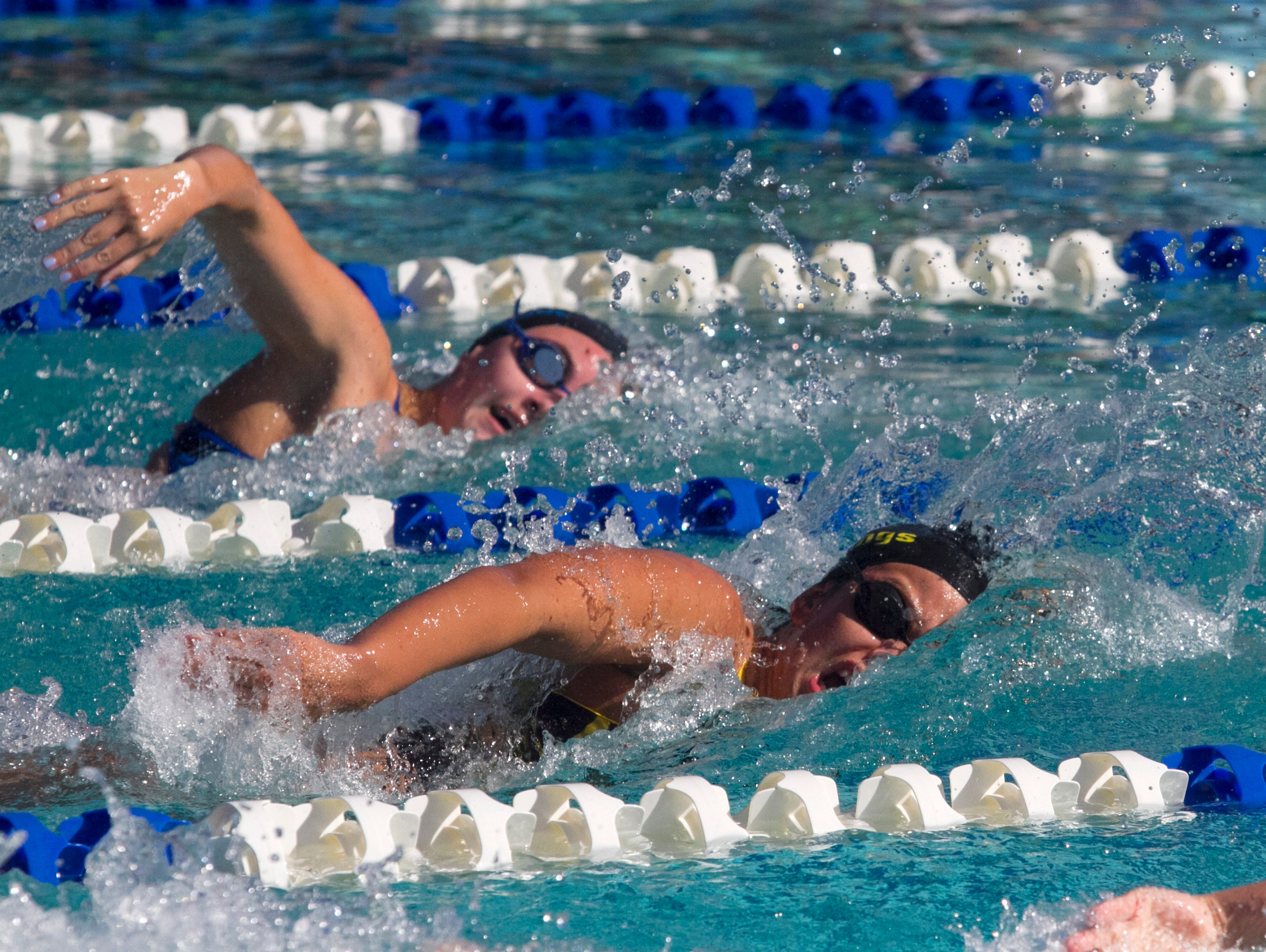 Florencia Almanda, right, of Bishop Verot and Emma Feehery of Community School of Naples swim the 200 Yard Freestyle at the 1A District 9 Swimming Championships on Wednesday. Feehery finished first and Almanda was second place. Almanda's teammate, Hannah VanDress finished third.