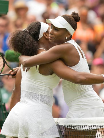 Serena Williams (USA) and Venus Williams  hug at the