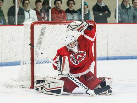 Arrowhead goalie Peter Genatempo deflects a shot over