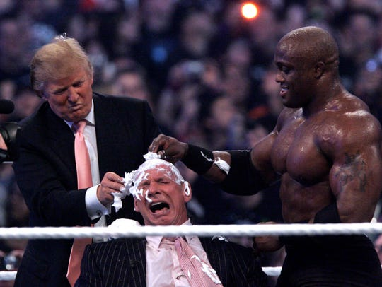 Donald Trump, left, and Bobby Lashley, right shave