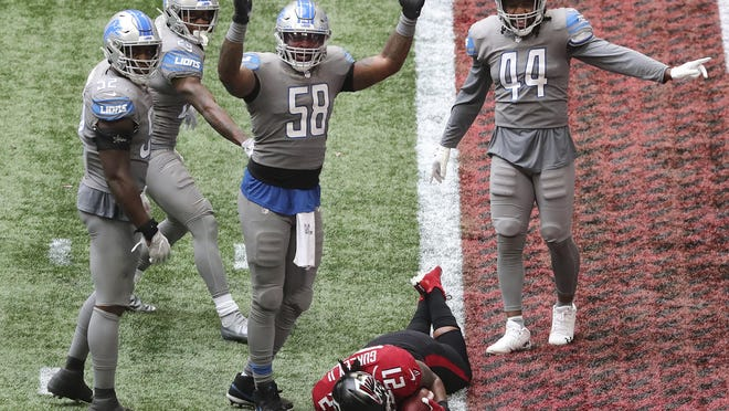 """Detroit Lions linebacker Jamie Collins (58) signals """"touchdown"""" as Atlanta Falcons running back Todd Gurley tries to stop short of the end zone to control the final minutes of the clock in the fourth quarter of an NFL football game Sunday, Oct. 25, 2020, in Atlanta."""