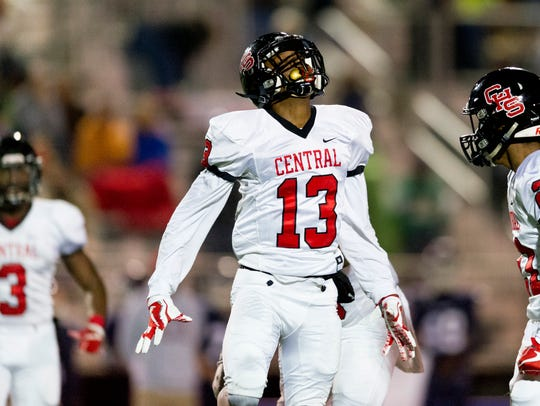 Central's Demetrian Johnson (13) celebrates after a