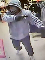 Authorities are looking for men involved in Greenfield armed robberies.
