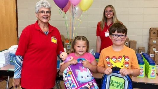 Altrusa of Door County volunteers pose with some of the children who participated in the recent Back-to-School Fair.