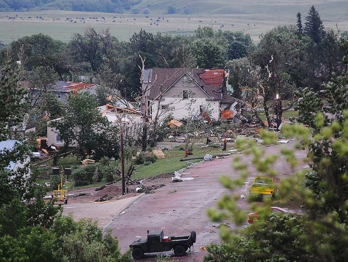 People search through wreckage June 19 a day after a tornado leveled homes and businesses in Wessington Springs, S.D. There were no reports of deaths or injuries.