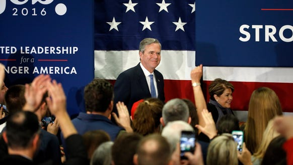 Jeb Bush, accompanied by his wife, Columba, moves to