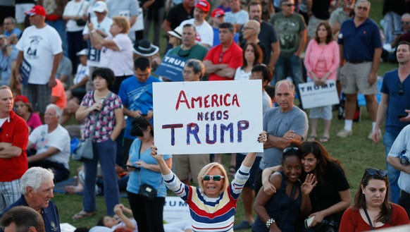 A supporter holds up a sign for Republican presidential