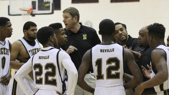 Neville coach Phillip Craig (center) and the Tigers