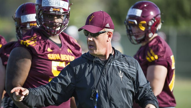 Chris Thomsen coaches the offensive line at the Arizona State University football practice in Tempe, Monday, March 14, 2016.