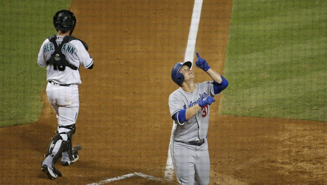 Los Angeles Dodgers center fielder Joc Pederson points after hitting a home run agains the Arizona Diamondbacks during the sixth inning at Chase Field June 14, 2016.