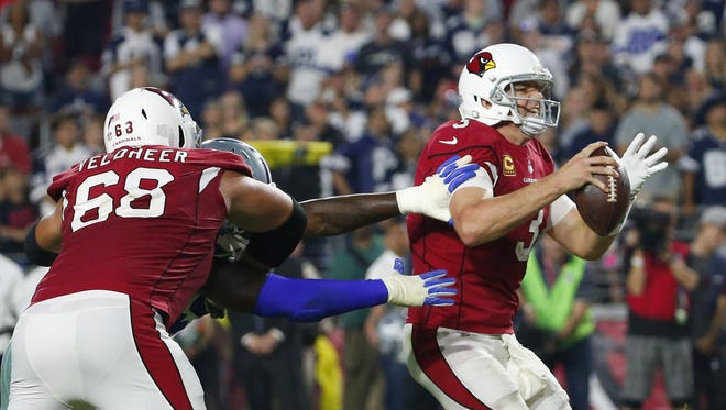 Arizona Cardinals quarterback Carson Palmer (3) gets pressure from Dallas Cowboys defensive end Demarcus Lawrence (90) who beat Arizona Cardinals offensive tackle Jared Veldheer (68) during the fourth quarter.