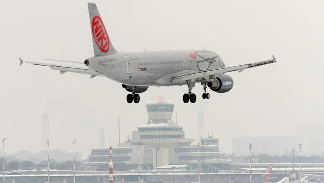 This file photo from Dec. 20, 2010, shows an airplane of Austrian airline Niki landing at Tegel airport in Berlin.