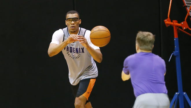 Phoenix Suns forward George King performs a shooting drill during Summer League practice at Talking Stick Resort Arena in Phoenix, Ariz. July 4, 2018.
