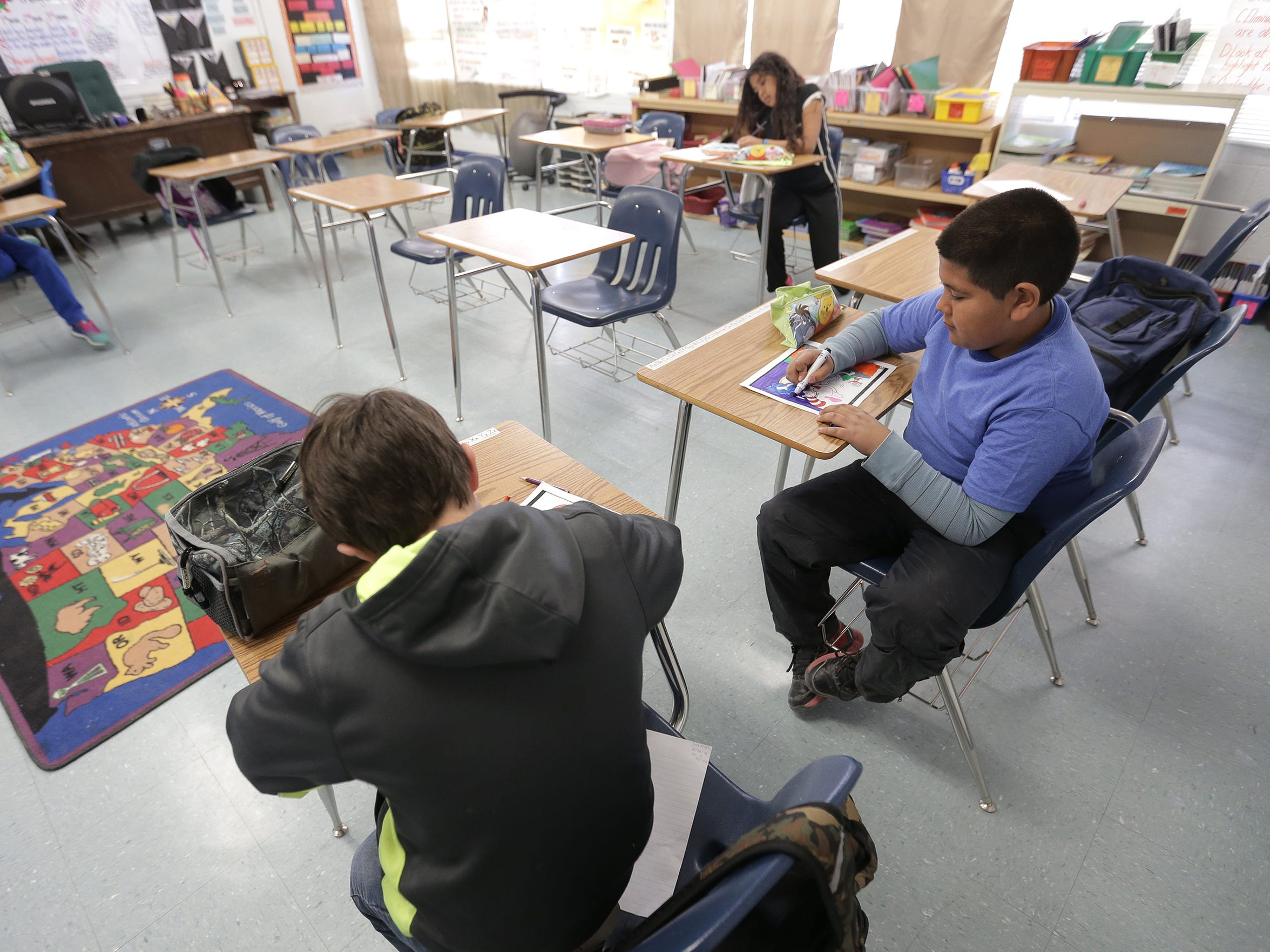 More desks are empty nowadays at Dell City School. With declining enrollment, elementary-level classes have been combined with another class.