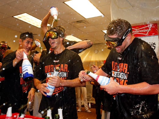 Game 3 in Detroit - Orioles 2, Tigers 1: The Orioles celebrate in the locker room after they sweep the Tigers to advance to the ALCS.