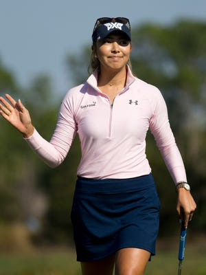 California native Alison Lee waves to the crowd after sinking a putt on the ninth hole during the CME Group Tour Championship at Tiburon Golf Club Thursday, Nov. 17, 2016 in Naples.