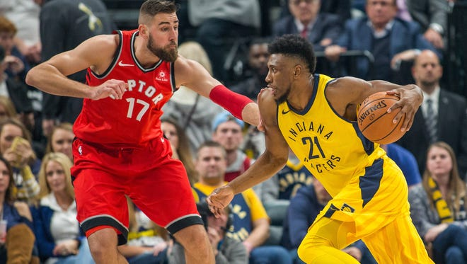 Nov 24, 2017; Indianapolis, IN, USA; Indiana Pacers forward Thaddeus Young (21) dribbles the ball against Toronto Raptors center Jonas Valanciunas (17) in the first quarter at Bankers Life Fieldhouse.
