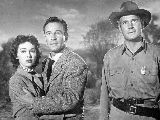 """Richard Carlson is flanked by Barbara Rush and Charles Drake in """"It Came From Outer Space."""""""