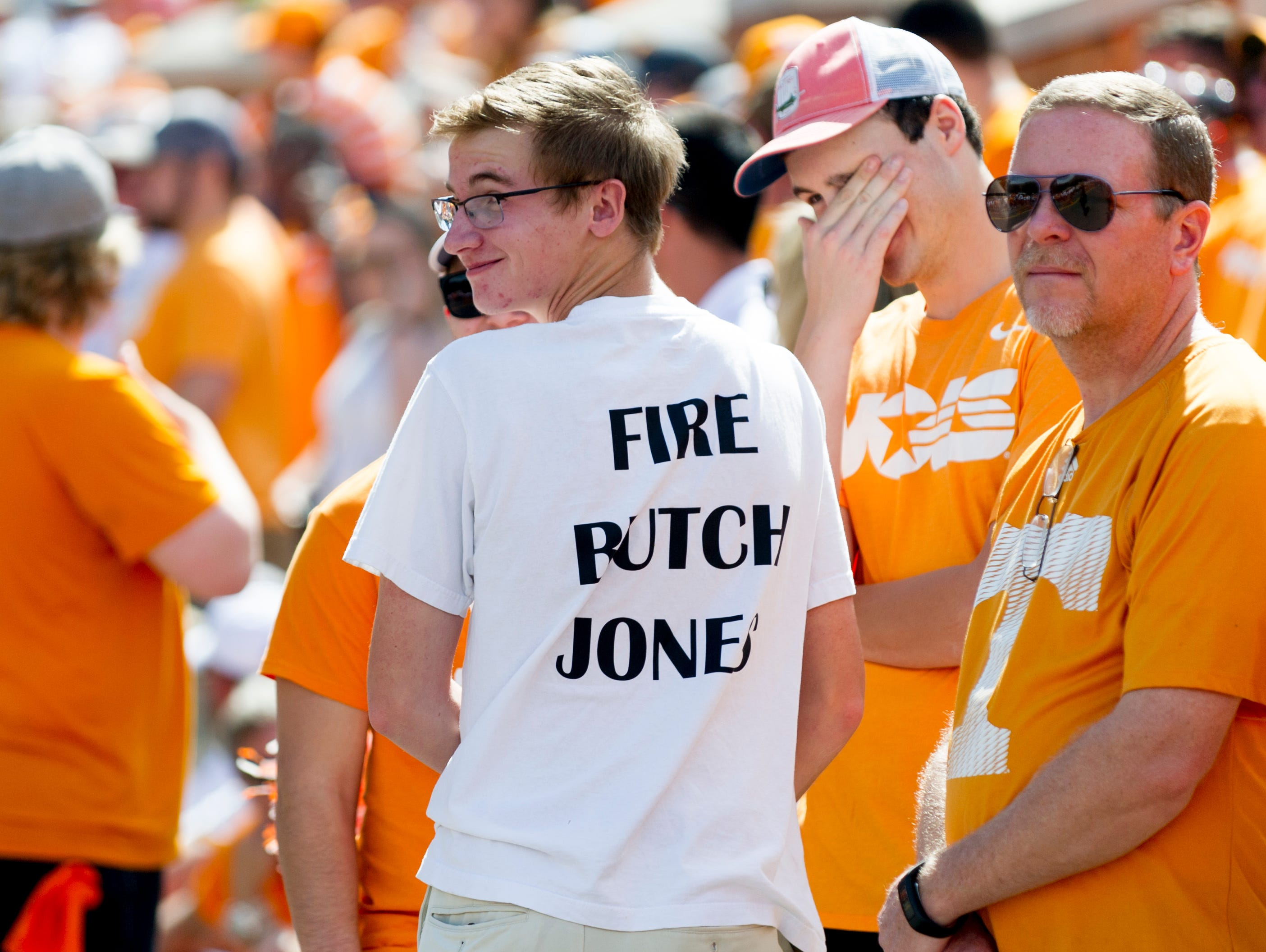"""A fan wears a """"Fire Butch Jones"""" t-shirt during the Tennessee Volunteers vs. Georgia Bulldogs game at Neyland Stadium in Knoxville, Tennessee on Saturday, September 30, 2017."""