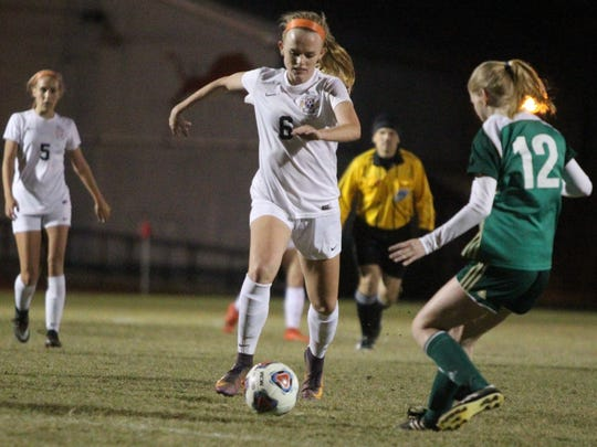 Leon's Maddie Powell dribbles up the field as Lincoln's defense braces.