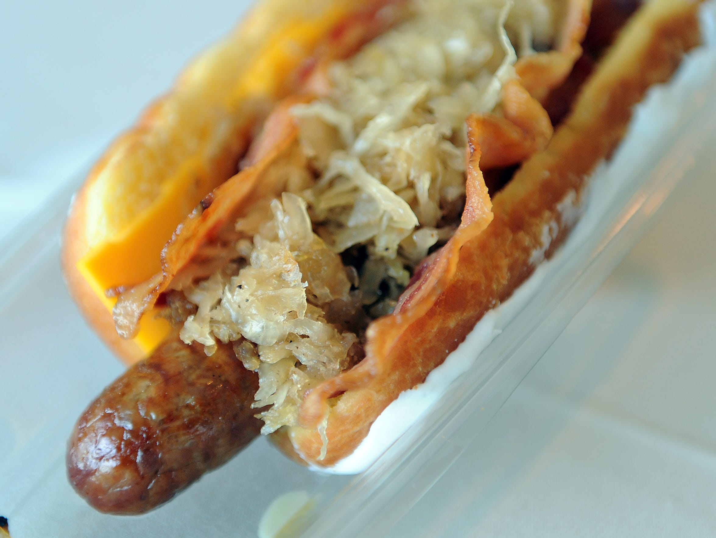 The Breakfast Brat is served on a maple long john.
