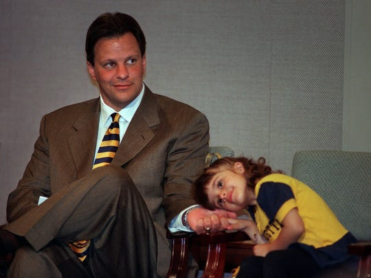 Tom Crean holds his daughter Megan's hand as he is introduced as Marquette's coach at a March 30, 1999 news conference.
