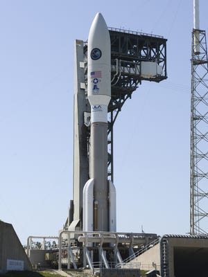 An Atlas V rocket sits poised for launch from Complex 41 at Cape Canaveral Air Force Station. The rocket is carrying a multi-payload mission for the US Air Force.