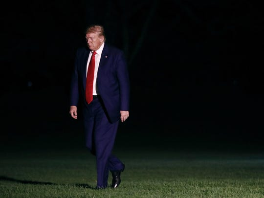 President Donald Trump walks on the South Lawn of the White House in Washington, Friday, Oct. 11, 2019, as he returns from a campaign rally in Minneapolis. (AP Photo/Patrick Semansky)