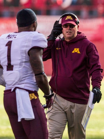 Minnesota coach Jerry Kill talks to receiver KJ Maye