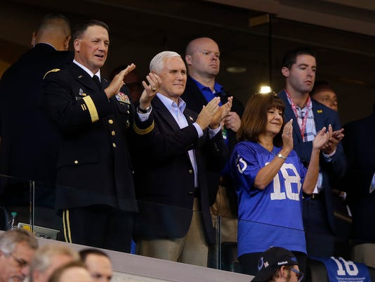 Vice President Mike Pence applauds before an NFL football game between the Indianapolis Colts and the San Francisco 49ers, Sunday, Oct. 8, 2017, in Indianapolis. (AP Photo/Michael Conroy)