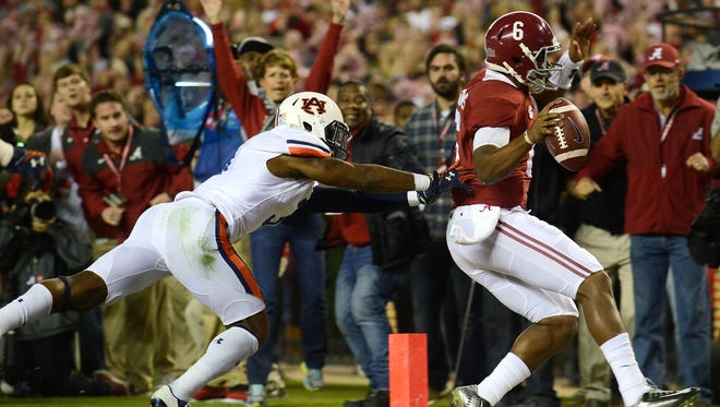 Alabama quarterback Blake Sims gets through the corner of the end zone for a touchdown in the fourth quarter against Auburn defensive back Jonathan Jones in the Iron Bowl at Bryant-Denny Stadium in Tuscaloosa, Ala. on Saturday November 29, 2014.
