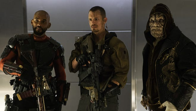 "Deadshot (Will Smith), Rick Flag (Joel Kinnaman) and Killer Croc (Adewale Akinnuoye-Agbaje) are ready to take on all comers in ""Suicide Squad."""