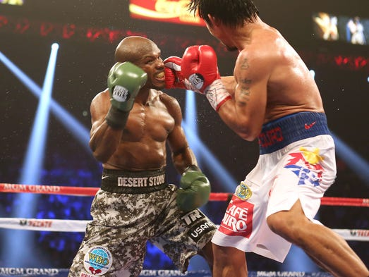 Timothy Bradley takes a shot from Manny Pacquiao during their rematch at the MGM Grand in Las Vegas, Saturday, April 12.