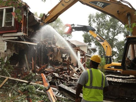 Crews tear down abandoned houses in Detroit in August
