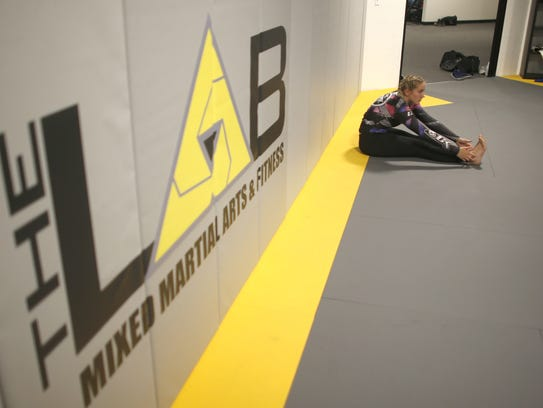 Rylee Bruce stretches out before class at MMA Lab after