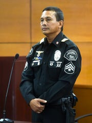 Airport Police Officer Vincent R.Q. Castro, 48, stands before the judge at his arraignment hearing at the Superior Court of Guam Northern Court Satellite in Dededo in this May 31, 2017 file photo.