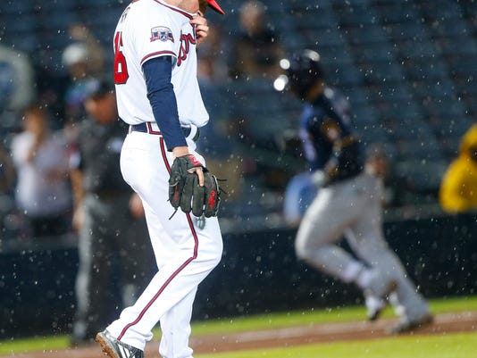 Atlanta Braves relief pitcher Ian Krol (46) paces on the mound as Milwaukee Brewers' Jonathan Villar rounds the bases after hitting a home run during the seventh inning of a baseball game Thursday, May 26, 2016, in Atlanta. (AP Photo/John Bazemore)
