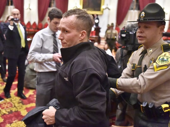 Single-payer protesters are arrested after refusing to leave the Statehouse in Montpelier on Thursday, January 8, 2015.